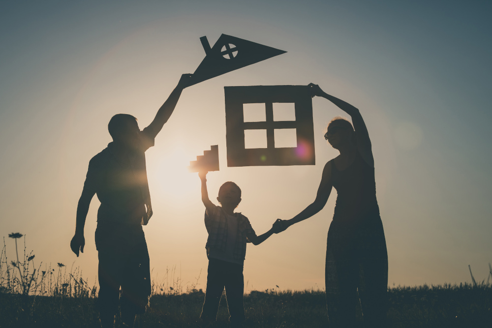 family holding paper house